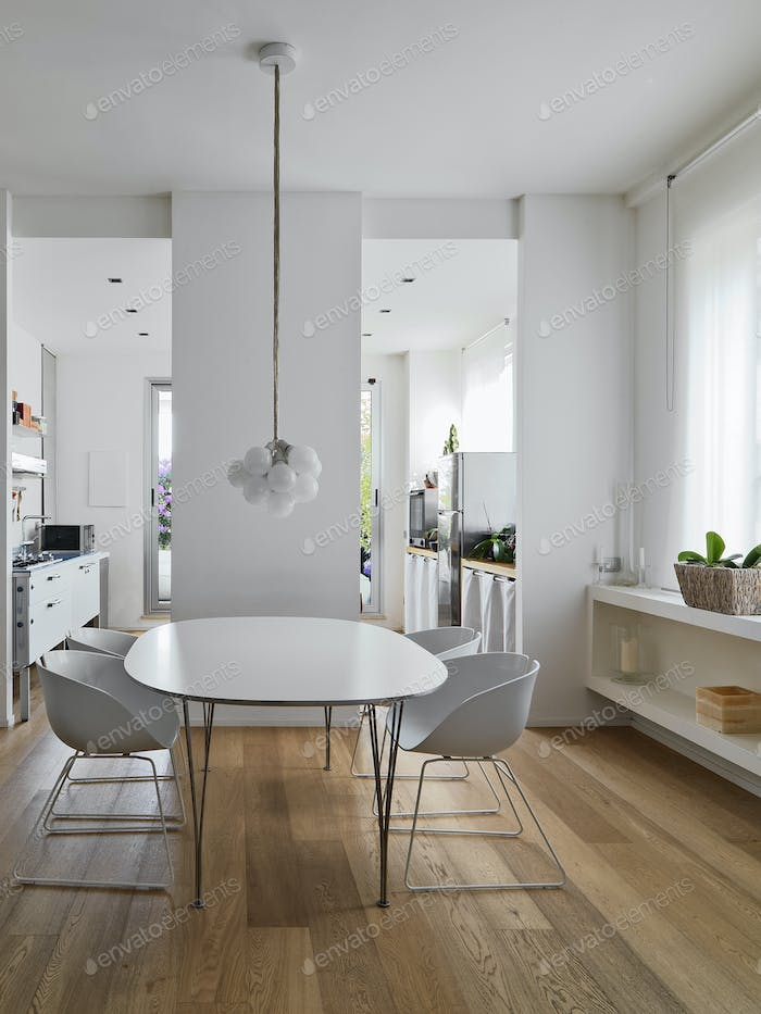Interiors of a Modern Dining Room with Wooden Floor