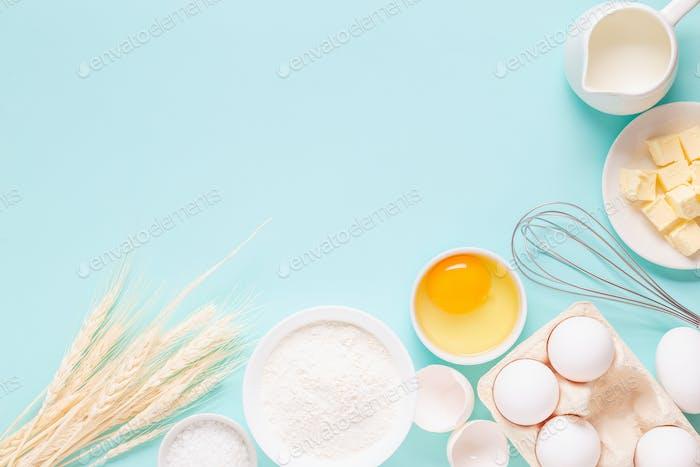 Ingredients for baking on light blue background.