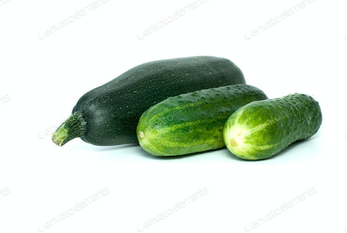 Cukini and pair of cucumbers