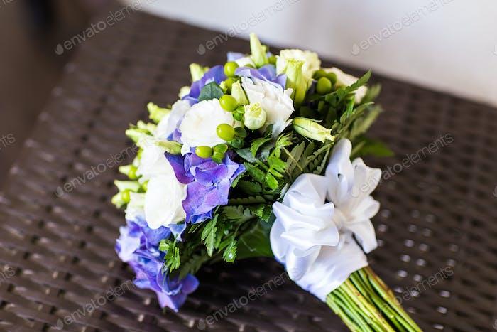 Bridal bouquet of various flowers.