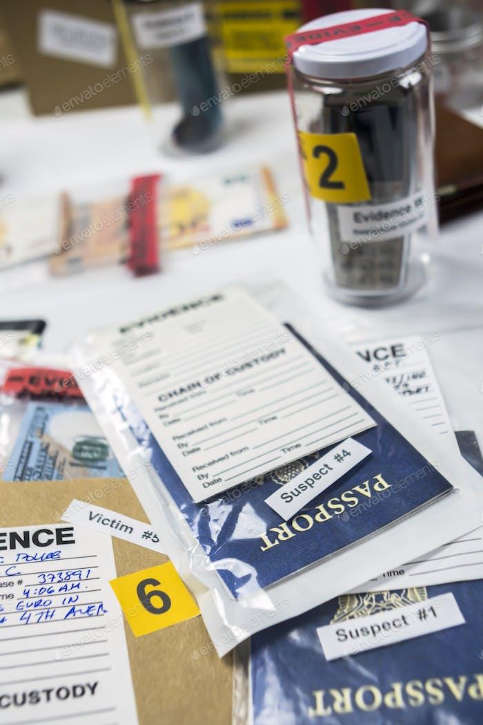 passports of suspects in criminal investigation unit, conceptual image