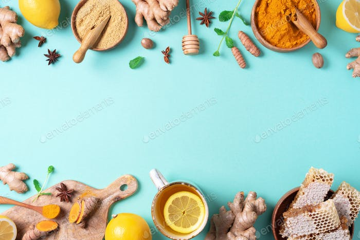 Organic ingredients for turmeric hot tea on blue background. Antiviral beverage. Healthy ayurvedic