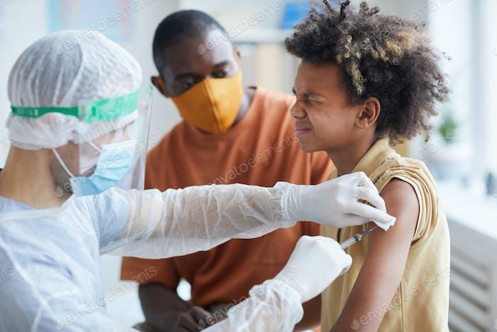 African-American Boy Afraid of Vaccination