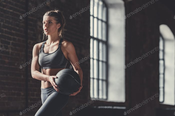 Young sporty girl with a ball