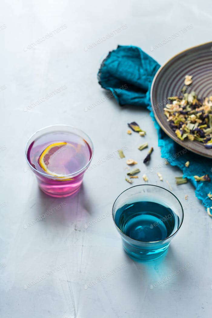 Blue butterfly pea flowers tea in a glass on table