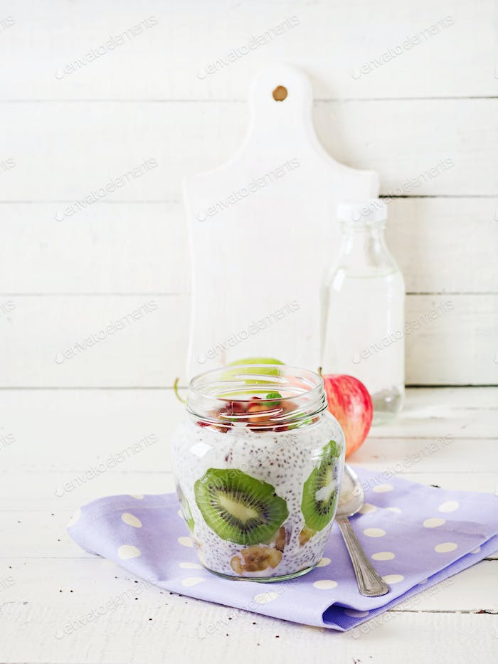 Chia pudding with fresh berries in glass jar.