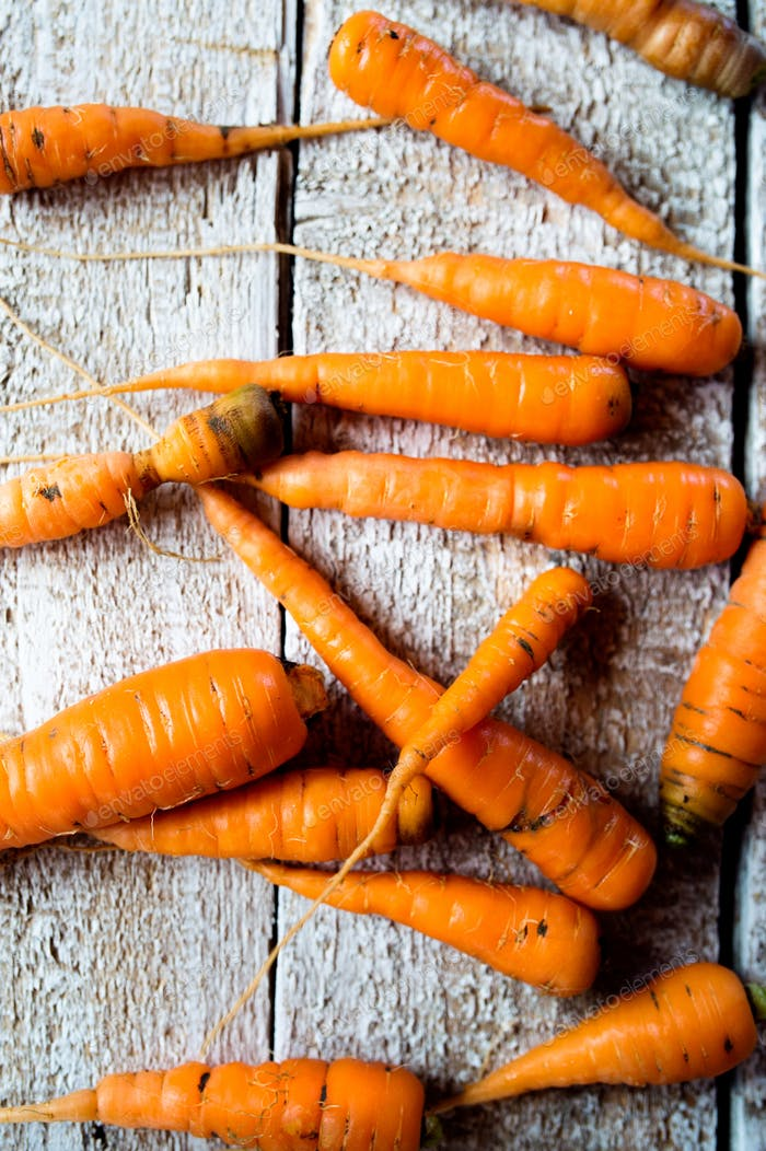 Fresh carrot vegetable laid on white wooden table