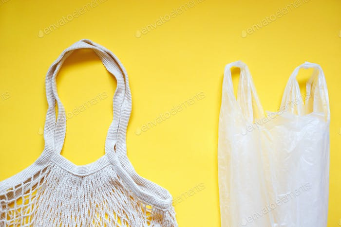 plastic bag with reusable tote bag for shopping on yellow background