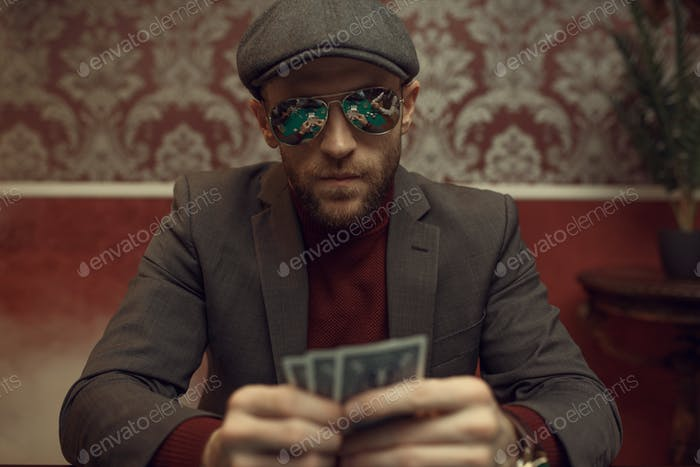Serious poker player playing in casino