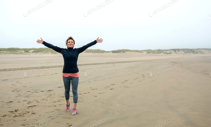 Young woman feeling free on the beach