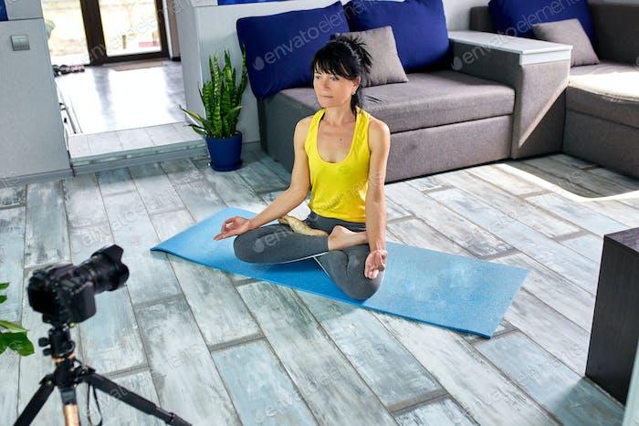 Blogger senior woman preparing special workout plan for senior people.