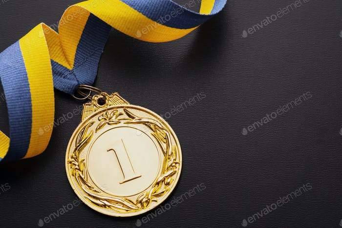 Champion or first placed winner gold medallion
