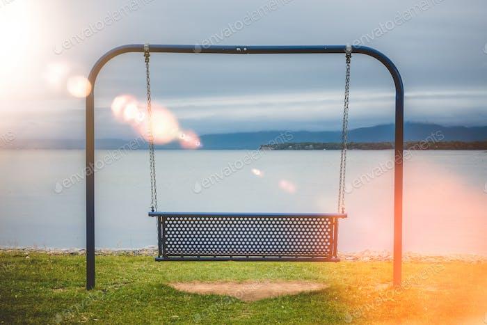 Swings at lake shore