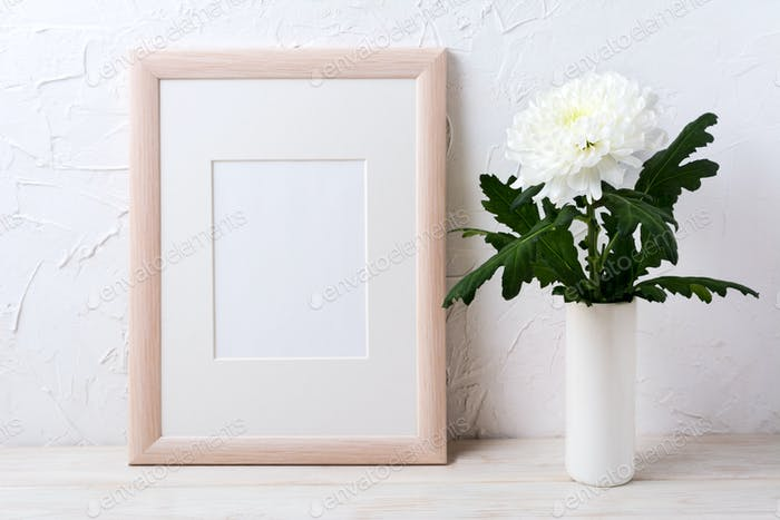 Wooden frame mockup with white chrysanthemum in vase