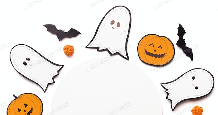 Composition of halloween ghosts, bats and pumpkins on white