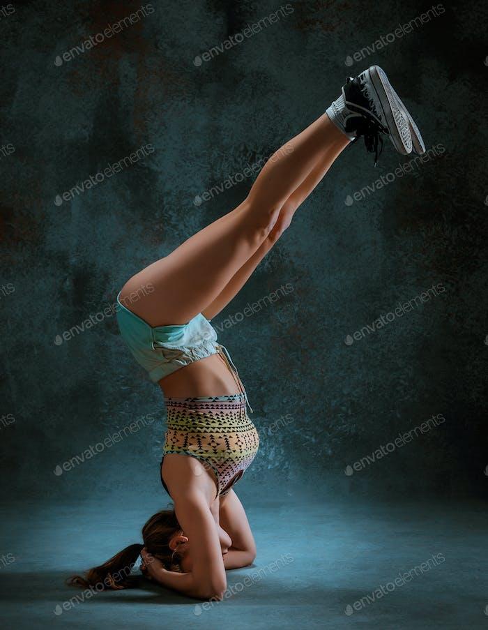 Attractive girl dancing twerk in the studio