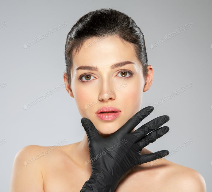 White woman in the black medical gloves.