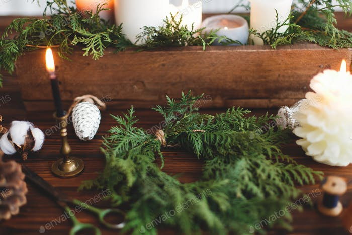 Making simple stylish christmas wreath with cedar branches, holiday advent