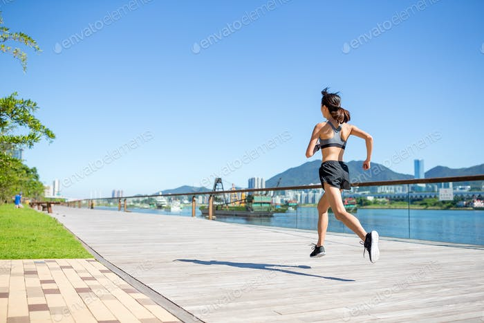 Back view of woman running in a city