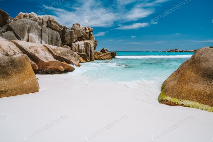 Anse Cocos, La Digue island, Seychelles. Tropical lagoon with granite boulders in the turquoise