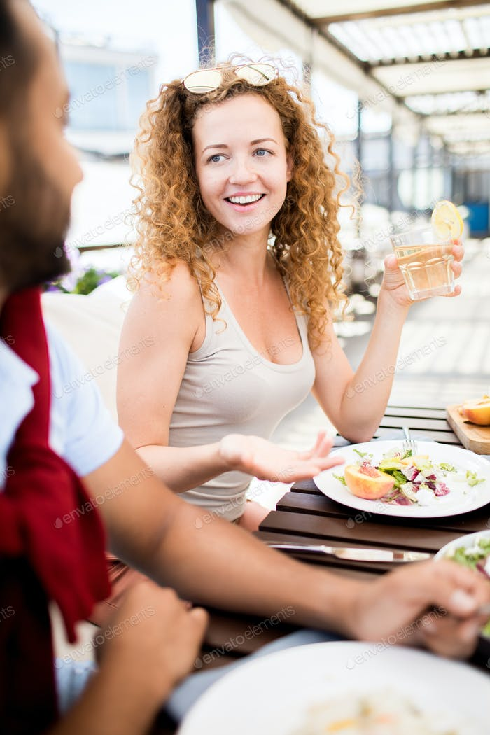 Woman Talking to Friend in Cafe