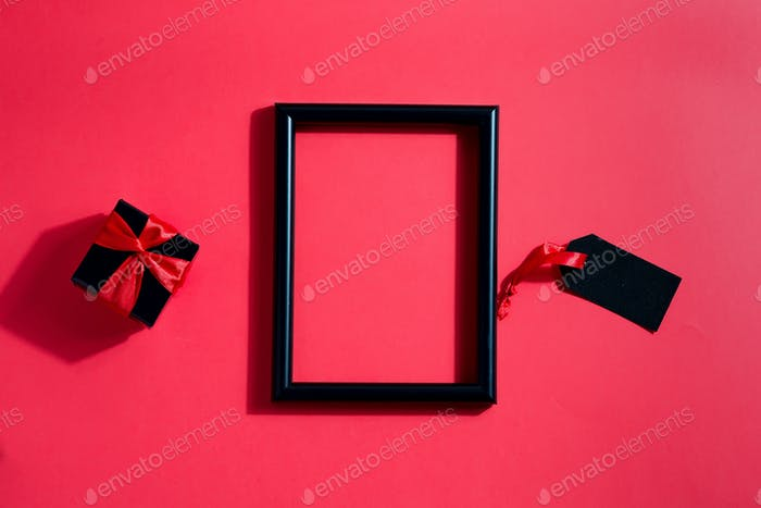 Black decorative photo frame with present box and label