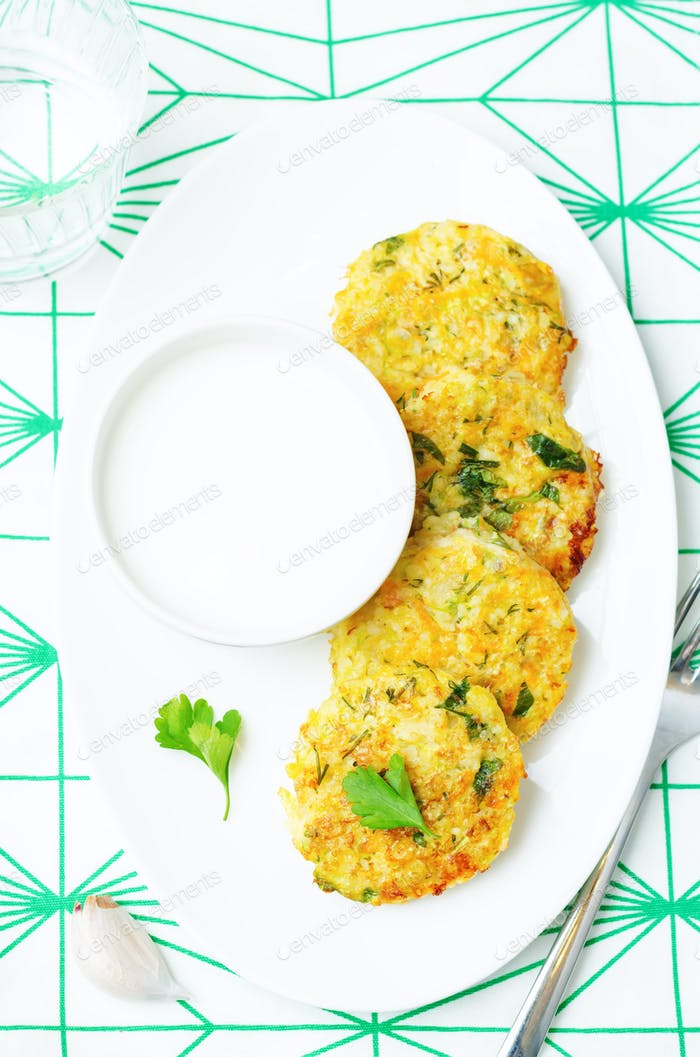 Cheesy millet zucchini fritters