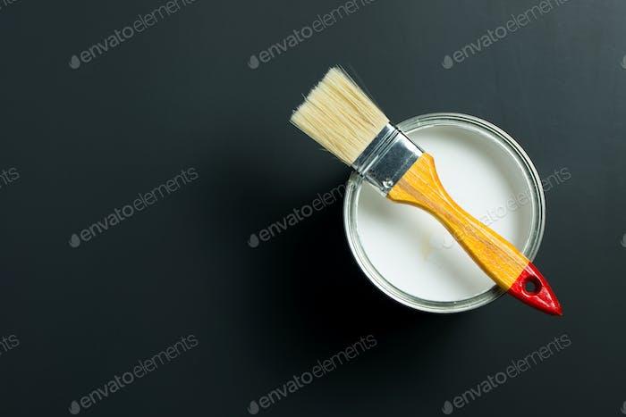 White paint and brush