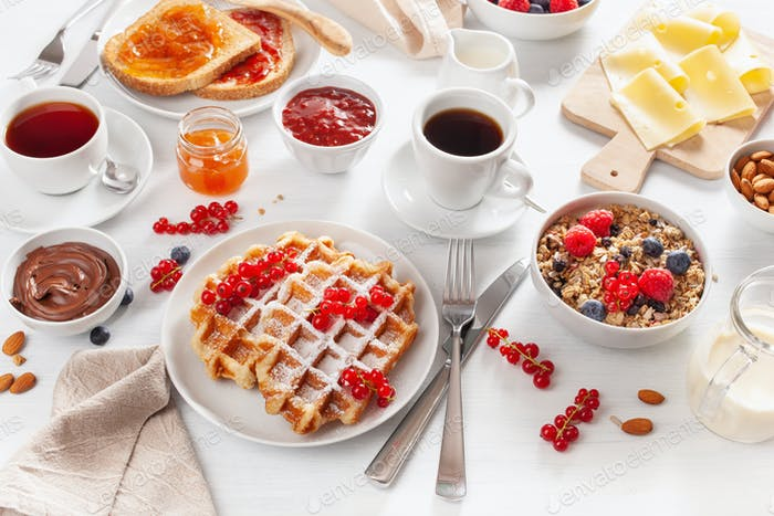 breakfast with granola berry nuts, waffle, toast, jam, chocolate
