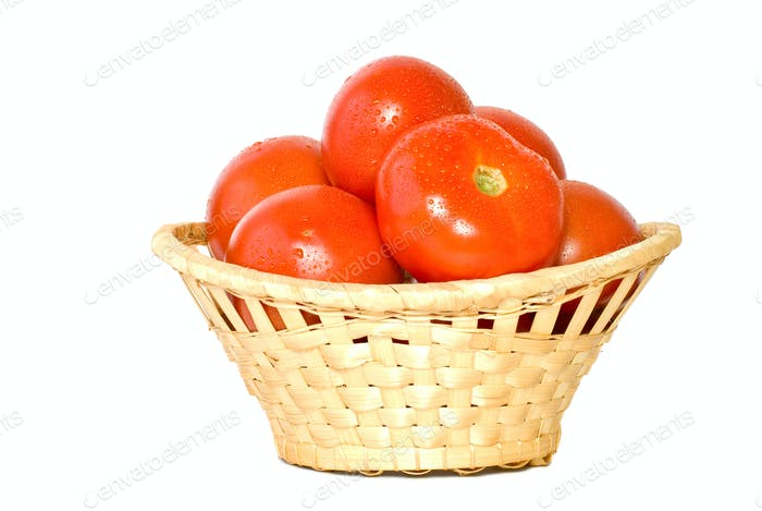 Wicker basket with tomatoes