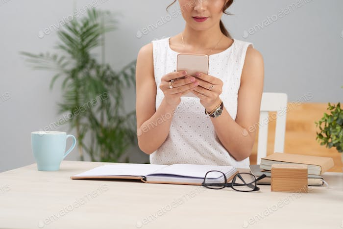 Business lady checking phone