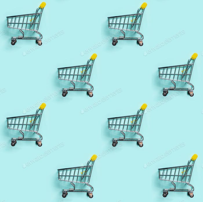 Shopping cart staggered on blue. Seamless pattern