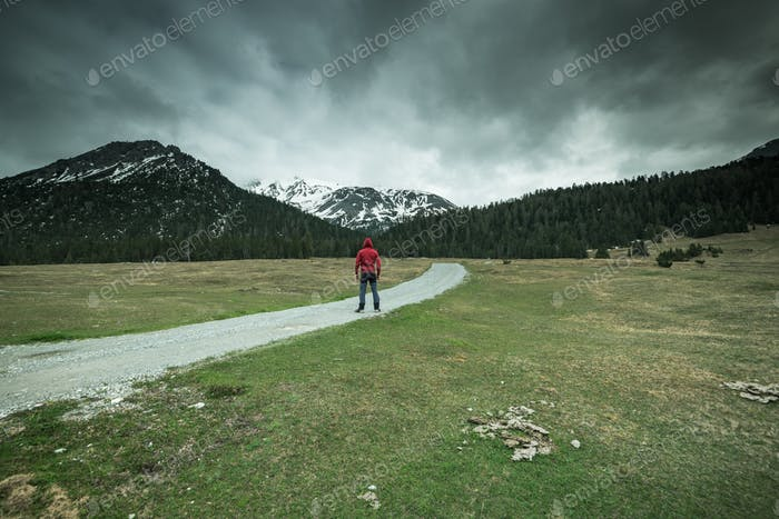 Man standing in front of mountains,moody concept