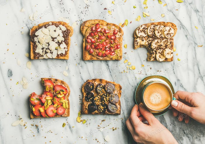 Healthy breakfast with wholegrain toasts , coffee over light marble background