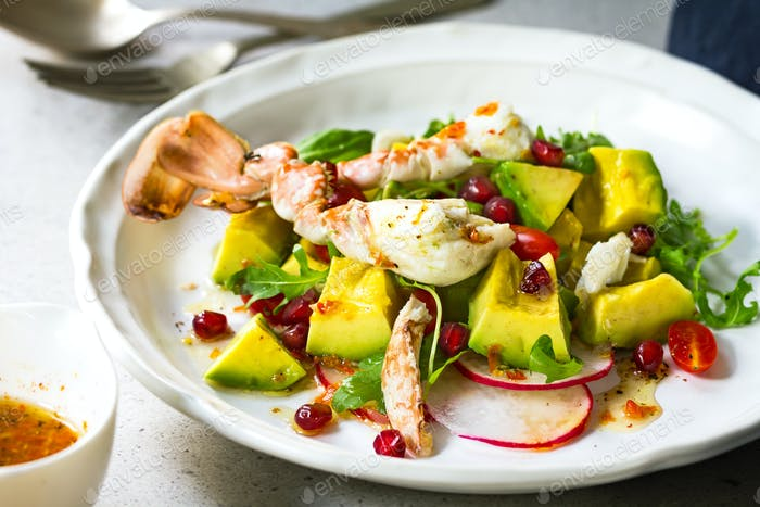 Crab with Avocado, Rocket and Pomegranate Salad by Lime and Chili Vinaigrette