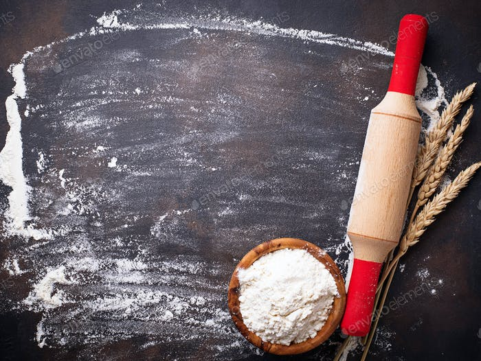 Wheat flour, ears and rolling pin