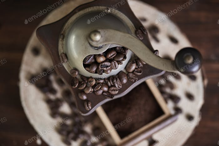 Close up of coffee grinder and beans