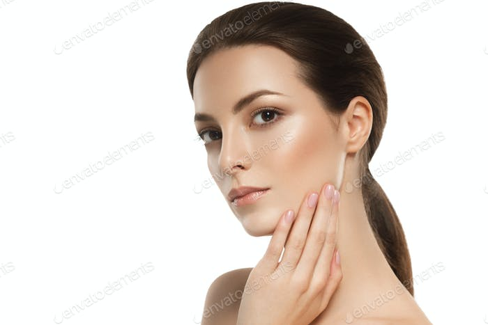 Beautiful skin face woman brunette hair natural makeup plastic surgery.