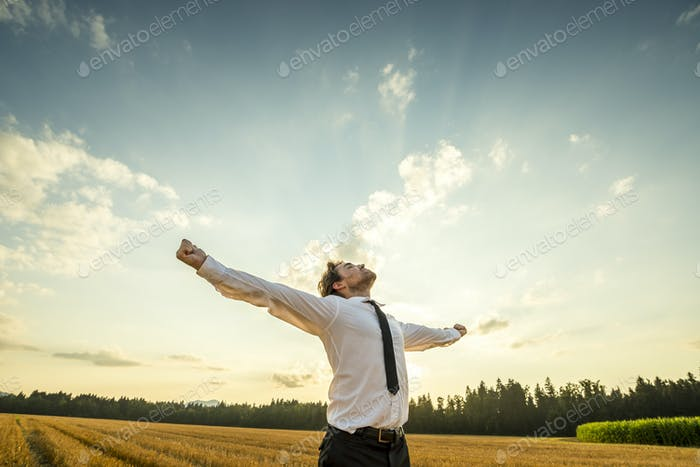 Thumbnail for Thankful Businessman with Open Arms at the Field