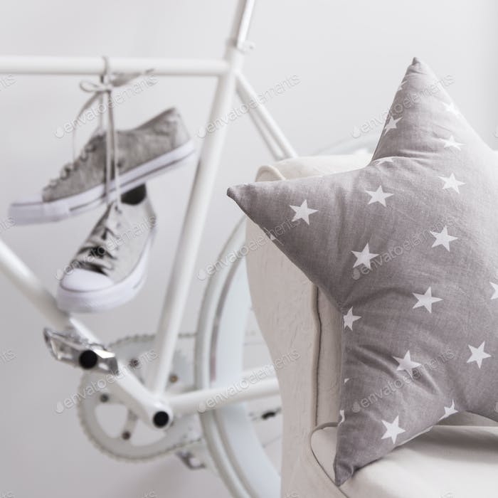 Shoes on bike in teenage room