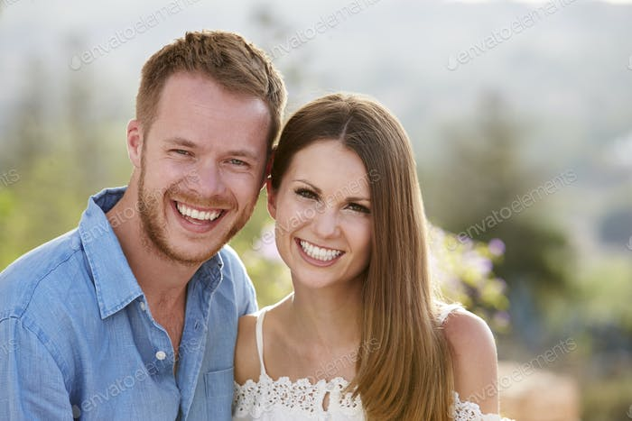 Portrait Of Romantic Young Couple On Holiday Together