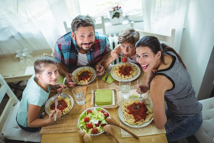 Elevated  view of family having meal together