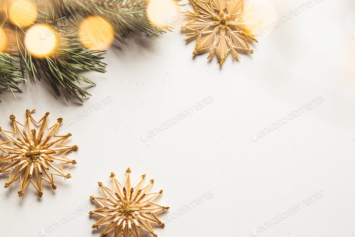 Homemade straw decor on Christmas tree close up