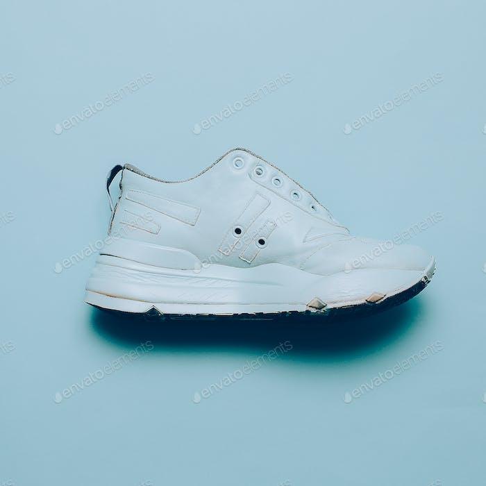 Blue Sneakers on the platform. Art gallery Minimal design
