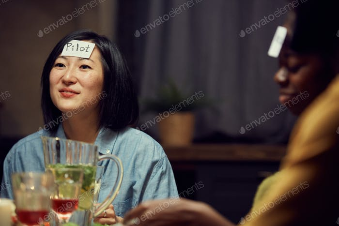 Asian Woman Playing Guessing Game at Party