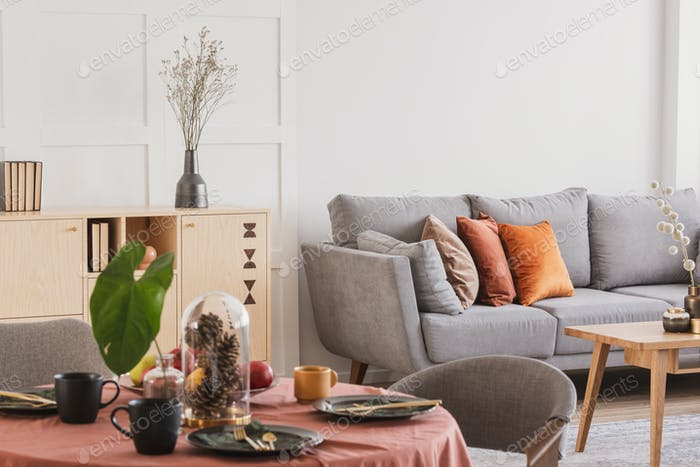 Closeup of dining room table set for family dinner meeting in classy living room interior
