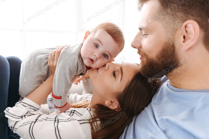 Cute young family. Parents having fun with their little child