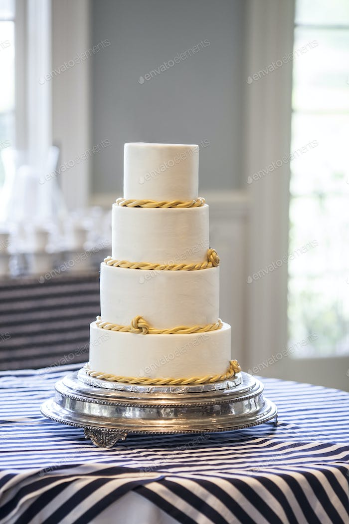 Plain four tiered wedding cake, place your own topper.
