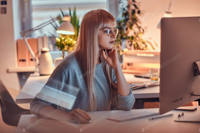 Attractive woman is working on computer
