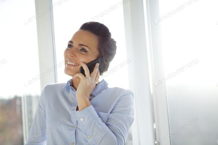 Woman talking in modern smartphone